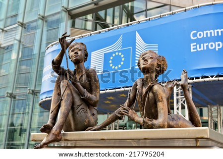 BRUSSELS, BELGIUM-SEPTEMBER 16, 2014: Modern office of European Commission institution decorated with a sculpture group - stock photo