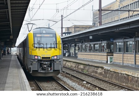 BRUSSELS, BELGIUM-SEPTEMBER 06, 2014: Train arrives to Brussels-South Railway Station or Gare du Midi. This is the biggest railway station of the city which was opened in 1952 - stock photo