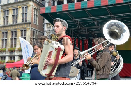 BRUSSELS, BELGIUM-SEPTEMBER 21, 2013: Unidentified street actors participate in activities on Grand Place after ceremony of award of costume to Manneken Pis  - stock photo