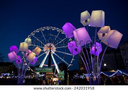 BRUSSELS - DECEMBER 28: Huge Ferris wheel in place Saint Catherine at Winter Wonders Christmas market on December 28, 2014 in Brussels.  - stock photo
