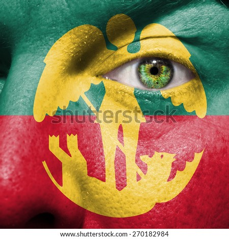 Brussels flag painted on a man's face to support his city Brussels - stock photo