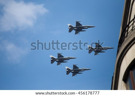 BRUSSELS - JULY 21: F-16 fighter planes vehicles during the military parade on the Belgium National Day. Photo taken on July 21, 2016 in Brussels, Belgium.