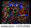 BRUSSELS - JULY 26: Pepin the Younger re-consecrated as king by Pope Stephen II in 754, on a stained glass window in the cathedral of Brussels, Belgium, on July 26, 2012. - stock photo