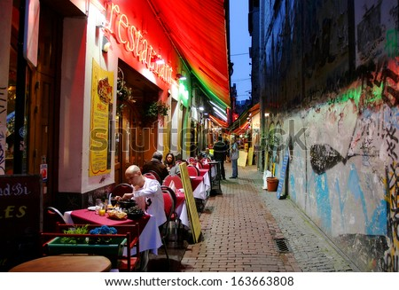 Brussels - July 12 2007:  Restaurants, bars and coffee shops at evening in historic part of the city are popular with locals and tourists visiting Brussles, Belgium on Jul 12 2007.. - stock photo