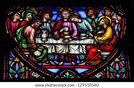 BRUSSELS - JULY 26: Stained glass window depicting Jesus and the twelve apostles on maundy thursday at the Last Supper in the cathedral of Brussels on July, 26, 2012. - stock photo