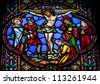 BRUSSELS - JULY 26: Stained glass window depicting Jesus on the cross in the cathedral of Brussels on July, 26, 2012. - stock photo