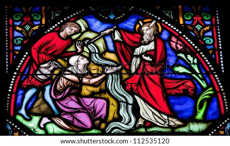 BRUSSELS - JULY 26: Stained glass window depicting Moses striking water from the rock. This window is located in the cathedral of Brussels and was photographed on July, 26, 2012. - stock photo