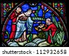 BRUSSELS - JULY 26: Stained glass window depicts Moses found in a basket in the Nile by Pharaoh's daughter, in the cathedral of Brussels on July, 26, 2012. - stock photo