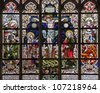BRUSSELS - JUNE 22: Crucifixion from windowpane in gothic church Notre Dame du Sablon on June 22, 2012 in Brussels. - stock photo