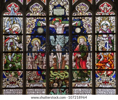 BRUSSELS - JUNE 22: Crucifixion from windowpane in gothic church Notre Dame du Sablon on June 22, 2012 in Brussels.