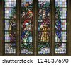 BRUSSELS - JUNE 22: Jesus rescues the sinful woman. Windowpane in National Basilica of the Sacred Heart built between years 1919 - 1969 on June 22, 2012 in Brussels. - stock photo
