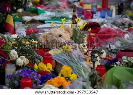 BRUSSELS - MARCH 29:Candles and flowers in front of the Stock Exchange to remember the victims of the terrorist attacks that took place on March 22. Photo taken on March 29, 2016 in Brussels Belgium.