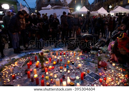 BRUSSELS - MARCH 23: People gathered in front of the Stock Exchange to remember the victims of the terrorist attacks that took place on March 22. Photo taken on March 23, 2016 in Brussels, Belgium.