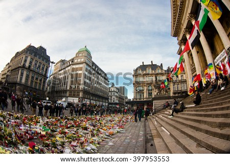 BRUSSELS - MARCH 29: People gathered in front of the Stock Exchange to remember the victims of the terrorist attacks that took place on March 22. Photo taken on March 29, 2016 in Brussels, Belgium.