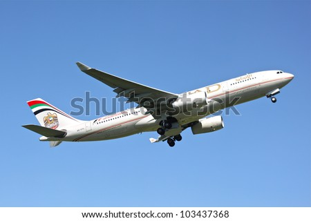 BRUSSELS - MAY 25: Airbus A330-243 of Etihad approaching Brussels Airport in Brussels, BELGIUM on May 25, 2012. Etihad is one of the most expensive and rated top 5 best airlines in the world - stock photo