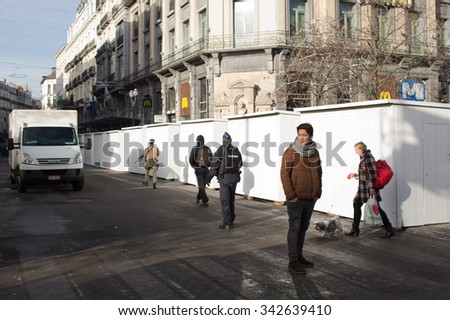 BRUSSELS - NOVEMBER 23: Belgium Army and police at Bourse, near central avenue of Brussels, as part of security lock-down following terrorist threats on November 23, 2015 in Brussels, Belgium.  - stock photo