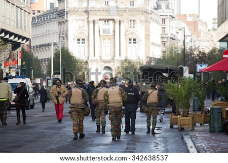 BRUSSELS - NOVEMBER 23: Belgium Army and police at De Brouckere, the central avenue of Brussels, due to security lock-down following terrorist threats on November 23, 2015 in Brussels, Belgium.