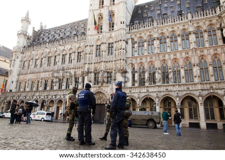 BRUSSELS - NOVEMBER 23: Belgium Army and police in Grand Place, the central square of Brussels due to security lock-down following terrorist threats. on November 23, 2015 in Brussels, Belgium.