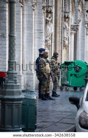 BRUSSELS - NOVEMBER 23: Belgium Army and police in Grand Place, the central square of Brussels part of security lock-down following terrorist threats. on November 23, 2015 in Brussels, Belgium.