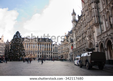 BRUSSELS - NOVEMBER 22: Belgium Army armored vehicle and a police vehicle parked in Grand Place, the iconic central square of Brussels on November 22, 2015 in Brussels, Belgium.   - stock photo