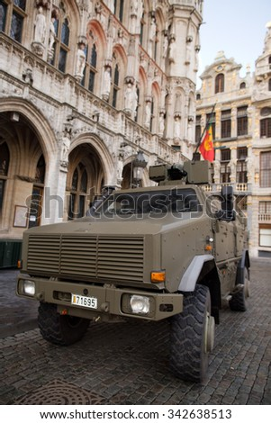 BRUSSELS - NOVEMBER 23: Belgium Army armored vehicle in Grand Place, the central square of Brussels due to security lock-down following terrorist threats. on November 23, 2015 in Brussels, Belgium.