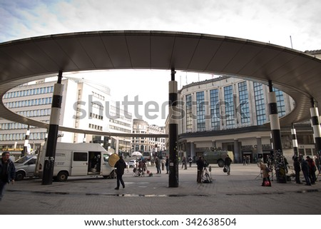 BRUSSELS - NOVEMBER 23: Belgium Army armored vehicle surrounded by press teams at the Main Railway station of Brussels on November 23, 2015 in Brussels, Belgium. Brussels is on full security alert. - stock photo