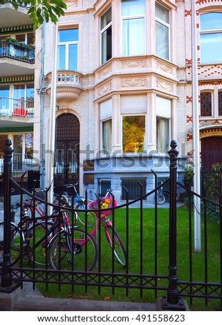 BRUSSELS-OCT. 1: A typical private residence with children's bicycles is seen by Parc du Cinquantenaire in Brussels, Belgium on October 1, 2015.