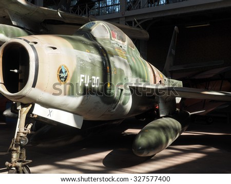 BRUSSELS-OCT. 1: An f 84 f thunderstreak military antique airplane is seen on display at Royal Museum of the Armed Forces and of Military History in Brussels, Belgium on Oct. 1, 2015. - stock photo