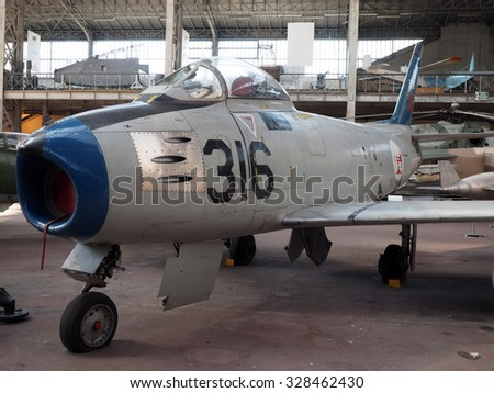 BRUSSELS-OCT. 1: An  F-86  Sabre  antique fighter airplane is seen on display at the Royal Museum of the Armed Forces and of Military History in Brussels, Belgium on Oct. 1, 2015. - stock photo