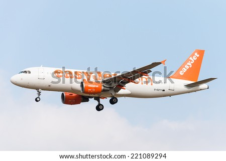 BRUSSELS - SEPTEMBER 30: Airbus A320-214 of EasyJet approaching Brussels Airport in Brussels, BELGIUM on SEPTEMBER 30, 2014. EasyJet is a British airline carrier and is the largest airline of the UK. - stock photo