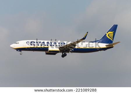 BRUSSELS - SEPTEMBER 30: Boeing 737-8AS of Ryanair approaching Brussels Airport in Brussels, BELGIUM on SEPTEMBER 30, 2014. Ryanair is an Irish low-cost airline. - stock photo