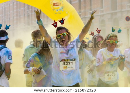 BRUSSELS - SEPTEMBER 7:Brussels Color Run on September 7, 2014 in Brussels. The Color Run is the happiest 5k run. The runners start with a white t-shirt and get covered in colored powder in the race.  - stock photo