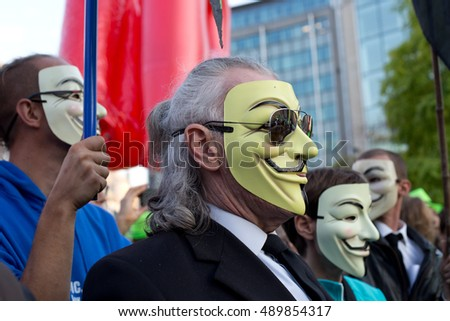BRUSSELS - SEPTEMBER 20: Protestors wearing Guy Fawkes maskes during manifestation against the trade agreements TTIP and CETA in  Brussels on September 20, 2016 in Brussels, Belgium.