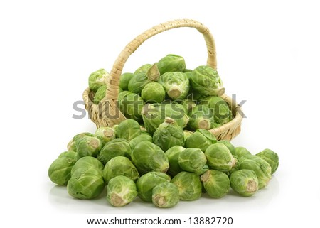 Brussels sprouts in a basket on bright background