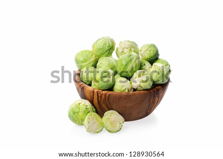 Brussels sprouts in a bowl on white