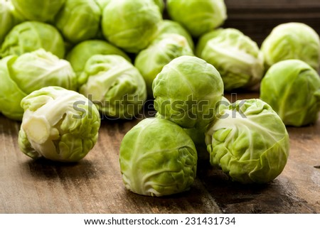 Brussels sprouts on a wooden underground - stock photo