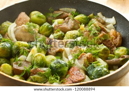 Brussels sprouts roasted with mushrooms and onions - stock photo