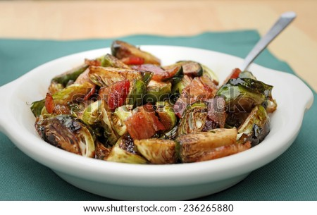 Brussels sprouts with bacon in a bowl with spoon. - stock photo