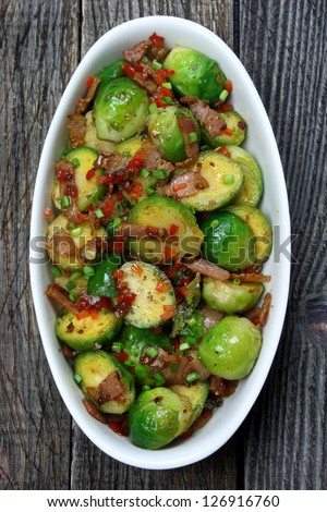 Brussels sprouts with bacon, onions and paprika - stock photo