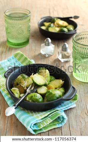 Brussels sprouts with sweet onions - stock photo