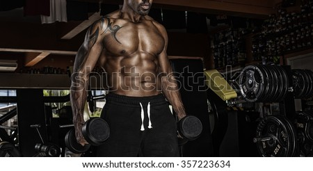 Brutal bodybuilder athletic man with six pack, perfect abs, shoulders, biceps, triceps and chest - stock photo