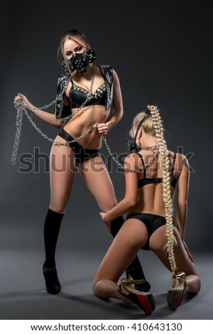 Brutal girl posing with sexy blonde chained