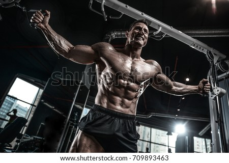 Gain stock images royalty free images vectors shutterstock brutal handsome caucasian bodybuilder working out training in the gym gaining weight pumping up muscles and ccuart Choice Image