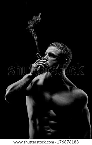 Brutal man with a cigar. Black and white portrait.