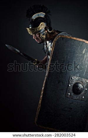 brutal warrior with sword and shield - stock photo