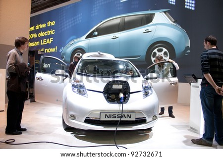 BRUXELLES, BELGIUM - JANUARY 14: Nissan Leaf electric car on display at Belgian Auto Salon 2012 on January 14, 2012 in Bruxelles, Belgium - stock photo