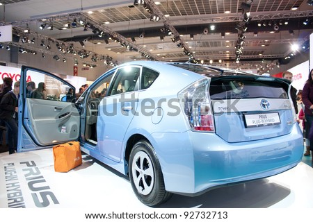 BRUXELLES, BELGIUM - JANUARY 14: Toyota Prius Hybrid plug-in car on display at Belgian Auto Salon 2012 on January 14, 2012 in Bruxelles, Belgium - stock photo