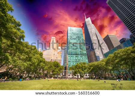 Bryant Park, New York City. Garden and trees on a beautiful summer day. - stock photo