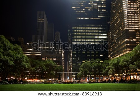 Bryant Park New York City Green Grass Skyline Apartment Buildings Night - stock photo