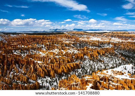 Bryce Canyon with snow and bright blue skies - stock photo